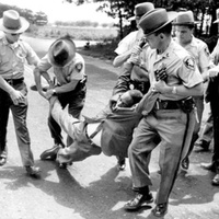 photo of Long Island CORE chairman Lincoln Lynch being arrested